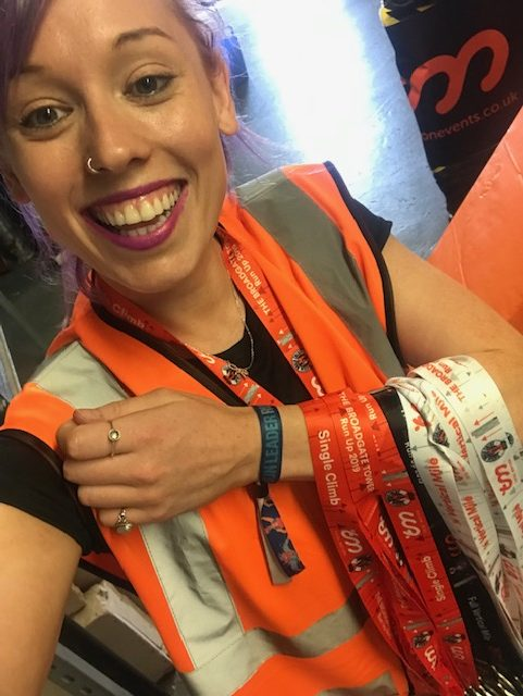 Volunteering; holding finishers medals